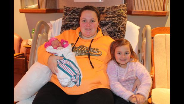 Sarah Stankus, 4, welcomes her new baby sister, Sophia Michelle Stankus, who is the first baby of the new year to be born at Pulaski Memorial Hospital. Mom Abigail Stankus said she wasn't expecting to have the first baby of the new year.