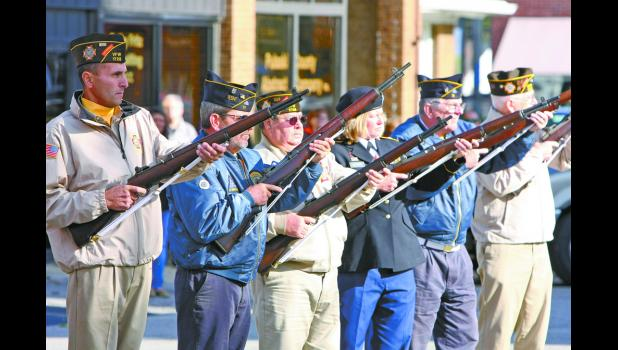 A gun salute is fired by members of the American Legion and VFW during the annual Veterans Day ceremony held at the courthouse.