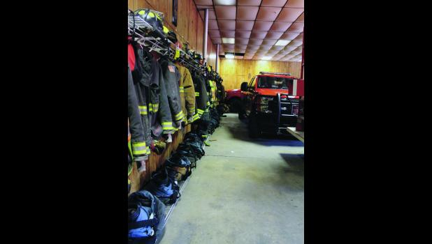 The Medaryville/White Post Volunteer Fire Department lacks space so much that the firefighters' gear lines one long wall and is exposed to the exhaust of the vehicles.