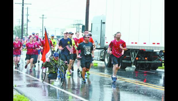 Local runners joined in the run through Pulaski County. The tribute to 20,000 military fallen and families started in Fort Irwin, California, and will conclude at Arlington National Cemetery in August.