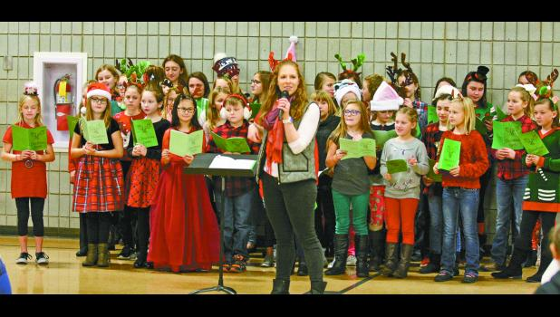 The EPES ExPrEsS choir under the direction of Emily Valenica got everyone in the holiday spirit during breakfast with Santa.