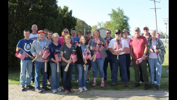 Volunteers and organizations made it possible for more than 1,800 flags to be placed on the graves of veterans who have passed on Saturday in time for Memorial Day. The organizations not only helped raise funds to purchase the flags but also placed them in various cemeteries in the county.