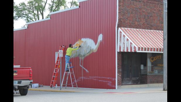 Artist Zach Medler is beginning on phase one of the Pulaski County Tribe sandhill crane mural project located on the corner of Main and National streets in Medaryville.