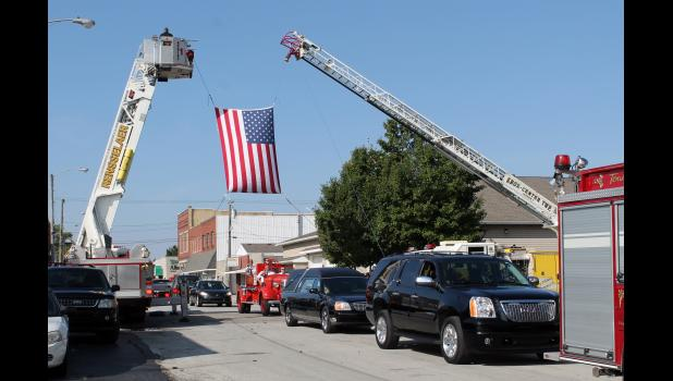 Sirens of fire trucks and emergency response vehicles could be heard before the funeral procession of Glenn Tiede Monday afternoon as it passed through Francesville. In his honor several area fire departments followed the procession and also secured the intersections as the cars traveled through.