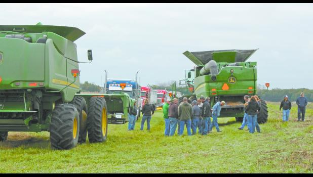 The community was seen sewing the seeds of giving as they helped to harvest corn in about 30 fields. Tim Reidelbach died on Oct. 10 from injuries sustained during an elevator explosion.