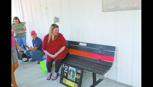 "The Star City Volunteer Fire Department honored one of their own on Saturday, as they unveiled and dedicated a bench to Michael Z. ""Bubba"" Shorter, who passed away on Jan. 22, 2017, from injuries sustained in a motorcycle accident. The bench was dedicated before a fundraiser at the Star City Volunteer Fire Department. Funds from the event were donated to  Shorter's widow,  Brandi,  and the  couple's  unborn  son."