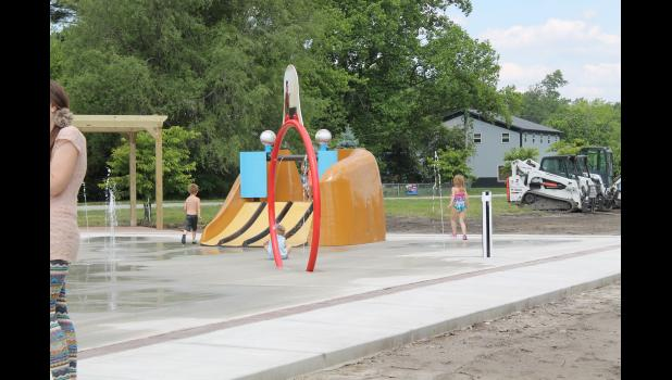 The splashpad being used on its grand opening day on Saturday, June 5.