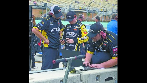A final pre-race strategy discussion with crew chief Kevin Bellicourt is had.