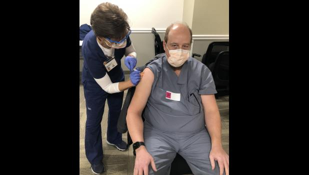 Pulaski Memorial Hospital Chief of Nursing Linda Webb vaccinated Dr. Clint Kauffman for COVID-19 on Dec. 18. The hospital staff assisted at Logansport Memorial in administering the first doses to area health care workers and providers.