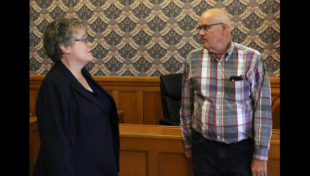 """State Rep. Doug Gutwein (R-Francesville) speaks with circuit court judge Mary Welker in her courtroom on Monday, Sept. 23, during a visit to the Pulaski County Courthouse in Winamac. Gutwein and Welker discussed his solution to fund renovations to the courthouse, which was recently added to Indiana Landmarks' """"10 Most Endangered List."""""""