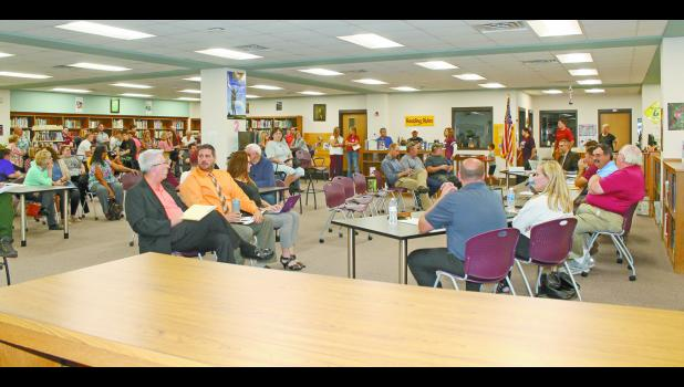 Numerous teachers, former students and community members who were concerned about the future of teacher and varsity basketball coach Kyle Johnson gathered in the Winamac Community Middle and High School Library during a regular school board meeting Monday evening.