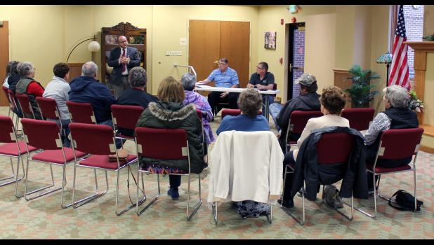 Jon Frain spoke with precinct committee members during a caucus on Dec. 23. He was elected as the next coroner that was effective Jan. 1.