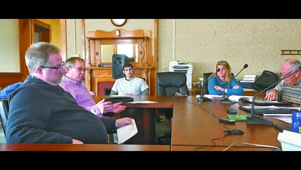 County recycling center and transfer station manager Brad Bonnell, Winamac Town Manager Brad Zellers and town councilmen Alvin Parish and Dave Schambers met with the commissioners Tuesday, Feb. 19, to discuss if the two entities can collaborate to offer Winamac residents curbside recycling.