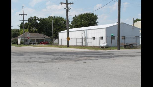 Wear and tear can be seen at the intersection of Bill and Lyman streets in Francesville, as semis make a turn onto private property.