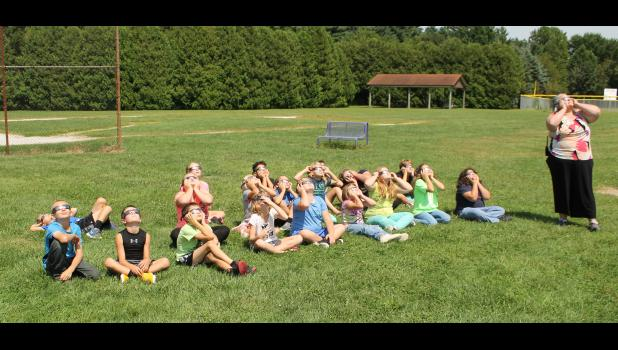 West Central Elementary students were able to enjoy the solar eclipse on Monday with the safety of glasses. Jennifer Byrne's fourth-grade class closely followed instructions and viewed the eclipse as a class. Byrne instructed the students when to don the glasses and for how long they could look before lowering their faces and taking their glasses off.