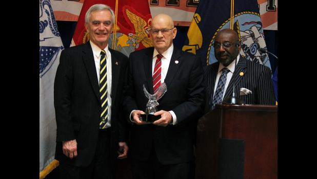 "State Rep. Doug Gutwein (R-Francesville) (center) received a ""Service Before Self"" Award from Indiana Military Veterans Legislative Day sponsors State Reps. Denny Zent (R-Angola) (left) and John Bartlett (D-Indianapolis) (right) honoring his military service and legislative efforts to help Hoosier veterans on Monday, Jan. 27, at the Statehouse in Indianapolis. A veteran of the Vietnam War, Gutwein worked on several pieces of legislation to help Hoosier veterans and active service members."