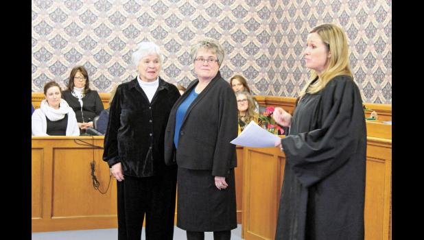 Pulaski Circuit Court Judge Mary Welker was sworn in again by Pulaski Superior Court Judge Crystal Brucker Kocher as part of a robing ceremony on Jan. 10.