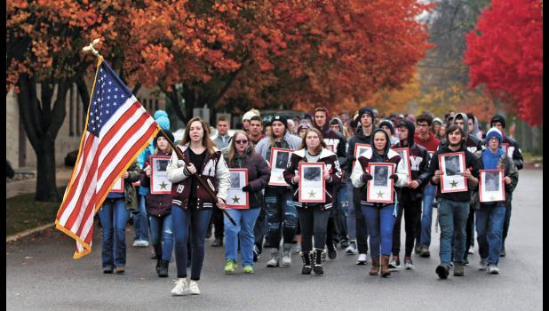 More than 300 Winamac Community High School students and faculty march in silence from the school to the courthouse carrying banners representing each veteran from Pulaski County that served in World War I.