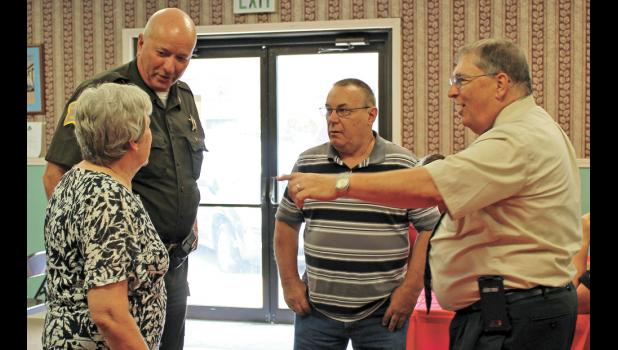 Friends, family, coworkers and local politicians gathered to congratulate prosecuting attorney Daniel Murphy on his retirement that became effective on Aug. 3. Murphy and his wife Linda enjoyed talking with several people including sheriff Jeff Richwine and former commissioner Terry Young at the Winamac Fire Station on Aug. 1.