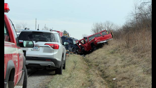 Bernard Mittica, former fire chief, was traveling south on U.S. 35 with his 11-year-old granddaughter when the red 2003 GMC Sierra they were in was hit partially head-on by a black 2002 Mercury Mountaineer, driven by Shawn Knebel, traveling north on U.S. 35., south of CR 315 S. The drivers of the vehicles were flown to South Bend Memorial Hospital for injuries. The 11-year-old was treated and released.