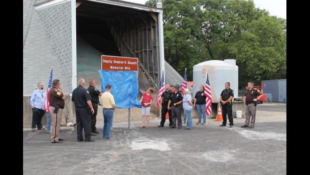 Several gathered to remember fallen officer Pulaski County Sheriff's Deputy Shadron K. Bassett during a ceremony on Friday. A mile of SR 39 is now renamed the Deputy Shadron K. Bassett Memorial Mile.