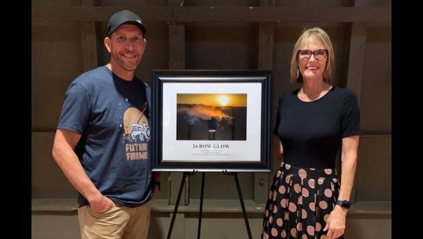 "Lt. Governor Suzanne Crouch congratulated Tom Jones as his photo, ""24 Row Glow,"" was chosen as a winner of the 2019 Indiana Agriculture photo contest. Photo by Carrie Intravaia"