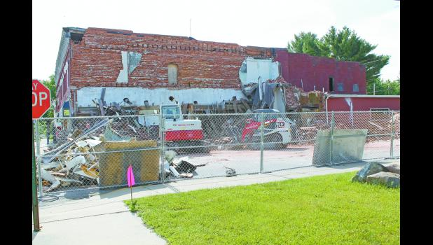 After a year of looking at an eyesore, Monterey residents are seeing the collapsed portion of the Sportsman's Bar and Grill cleaned up.