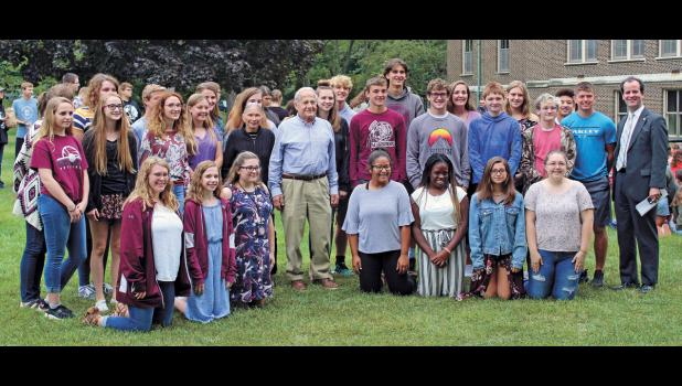 "Mr. Frank Grunwald, survivor of Auschwitz, along with his wife, Barbara, pose for a photo with the Winamac Community High School cast of the 2019 fall play, ""And Then They Came for Me: Remembering the World of Anne Frank."" Photo by Sophie Dickinson"