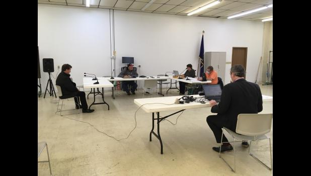 Pulaski County Council members held a meeting Monday evening with all but one member attending the meeting by phone.