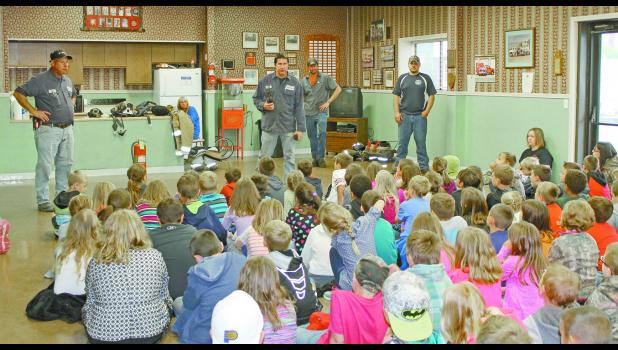 "Students first met with firefighters who donned their gear. Assistant chief Larry Weaver answered numerous questions from the students. One student asked Weaver what he likes about being a firefighter. ""It's very rewarding to be able to help people,"" Weaver said."