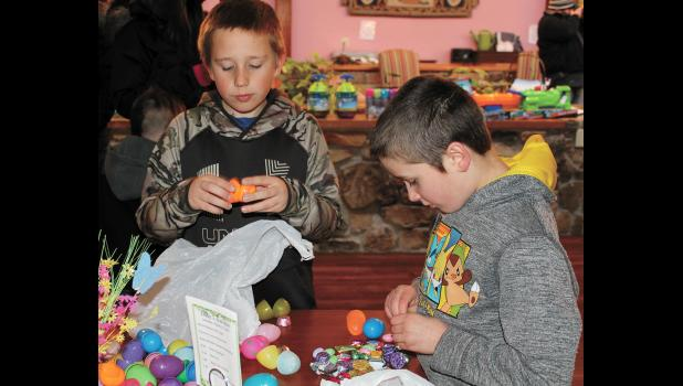 Maddox Gutwein, 9, Francesville, and Paetyn Koebcke, 9, Medaryville, eyed the candy they found in their eggs during Parkview Haven's annual egg hunt, held Saturday, March 24.