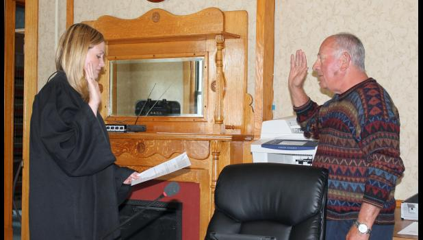 Pulaski Superior Court Judge Crystal Brucker Kocher officially swore in Mike McClure as the new commissioner for District 3, Tuesday evening.