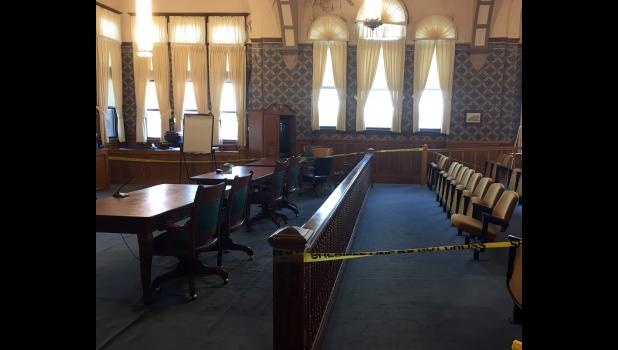 Warning tape was hung in the Pulaski Circuit Court to warn visitors that the ceiling is falling. The tape will soon be removed because of a jury trial. The temporary fix is to knock the loose portions of the ceiling down.