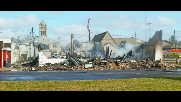 More than a year and a half after a fire that destroyed two buildings, the rubble has yet to be removed from one of the lots.