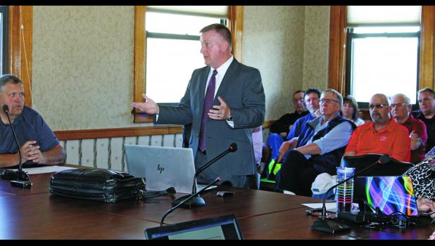 Jeff Peters, of Peters Municipal Consultants, spoke with the county commissioners and council, during a joint session April 8, about the financial crisis the county could face.