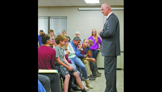 Eastern Pulaski Community School Corporation Board members approved to cancel the coaching contract of boys varsity basketball coach Kyle Johnson. Johnson thanked those who were in the audience for their support.