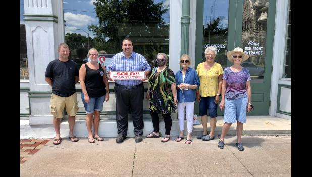 The Kastens, Mike and Jenny, and historical society board members, Ryan Harrison, Kathi Thompson, Lin Morrison, Becky Dilts and Janet Onken, recently celebrated the selling of the opera house.