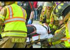 Crash victim Jet Terry is placed on a stretcher and transported to the hospital as part of a mock accident at Winamac Community High School.