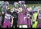 Winamac head coach Tim Roth joins his players to sing the Warrior fight song.