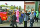 Eastern Pulaski Elementary second-grade students spent the day visiting the Winamac Fire Station in honor of Fire Prevention Week. Firefighter Bill Weaver explained the functions of a brush truck with the students. He also answered any questions they had.